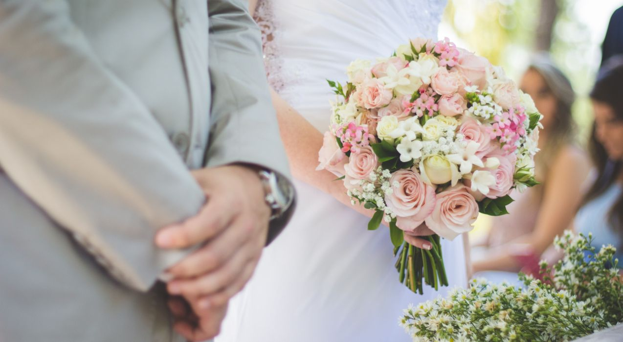Married Couples with Wedding Bouquet
